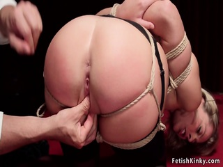 Gagged blonde pussy toyed on hogtie